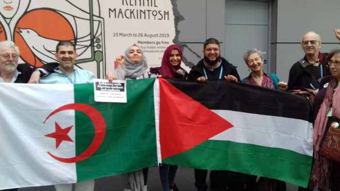 Activists at NEU congress 2019 show solidarity with the struggles in Palestine and Algeria for freedom. Picture: Miriam Scharf